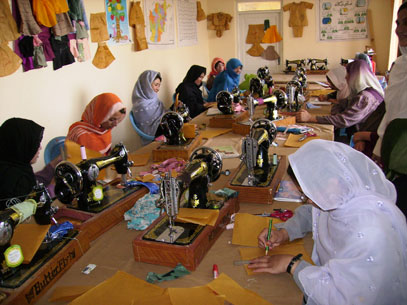 Women working on sewing machines.