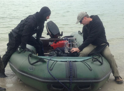 Divers preparing to go into a boat in Ukraine