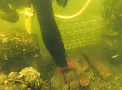 Divers removing an underwater ERW